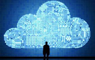 man staring at cloud representing cloud migration