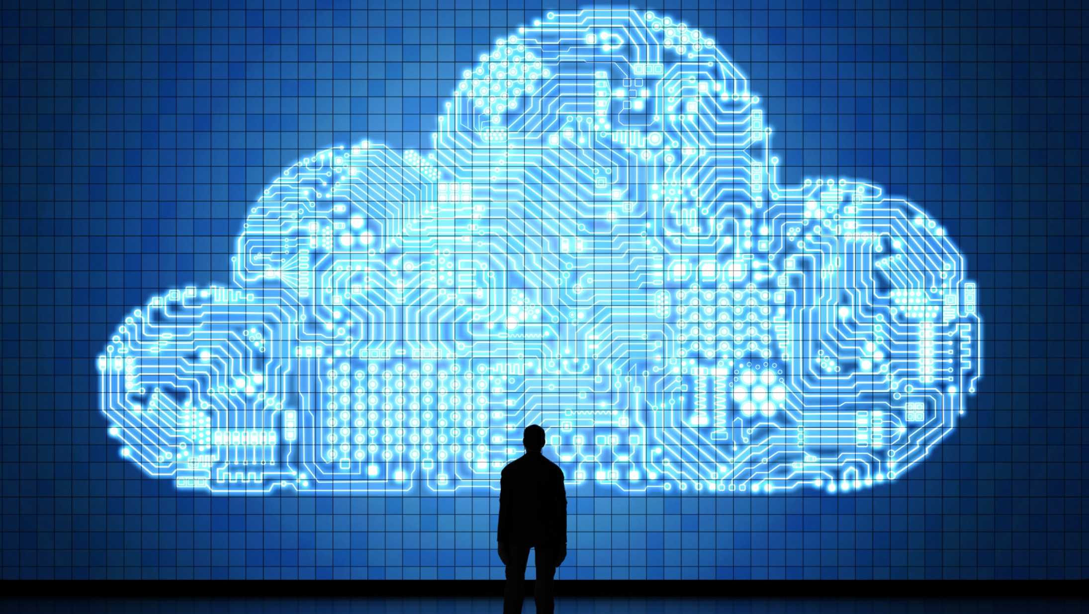 man staring at cloud representing cloud migration